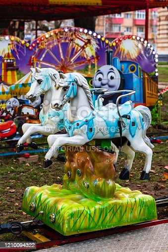 Horses carousel in the park for children in Targoviste, Romania, 2020.