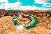 Horseshoe Bend, where the Colorado River runs through the spectacular Grand Canyon, a sunny day in Utah, USA.