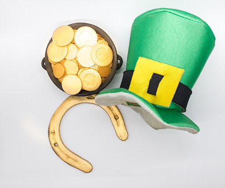 horseshoe galley and saint patrick's day coins on white background