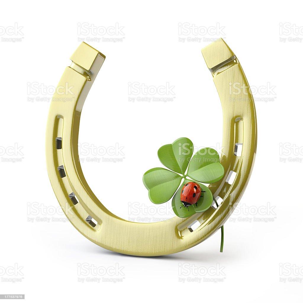 Horseshoe with leaf clover and a ladybug stock photo