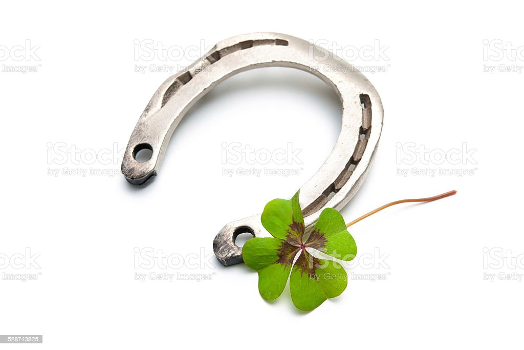 Horseshoes and clover with four leaf stock photo