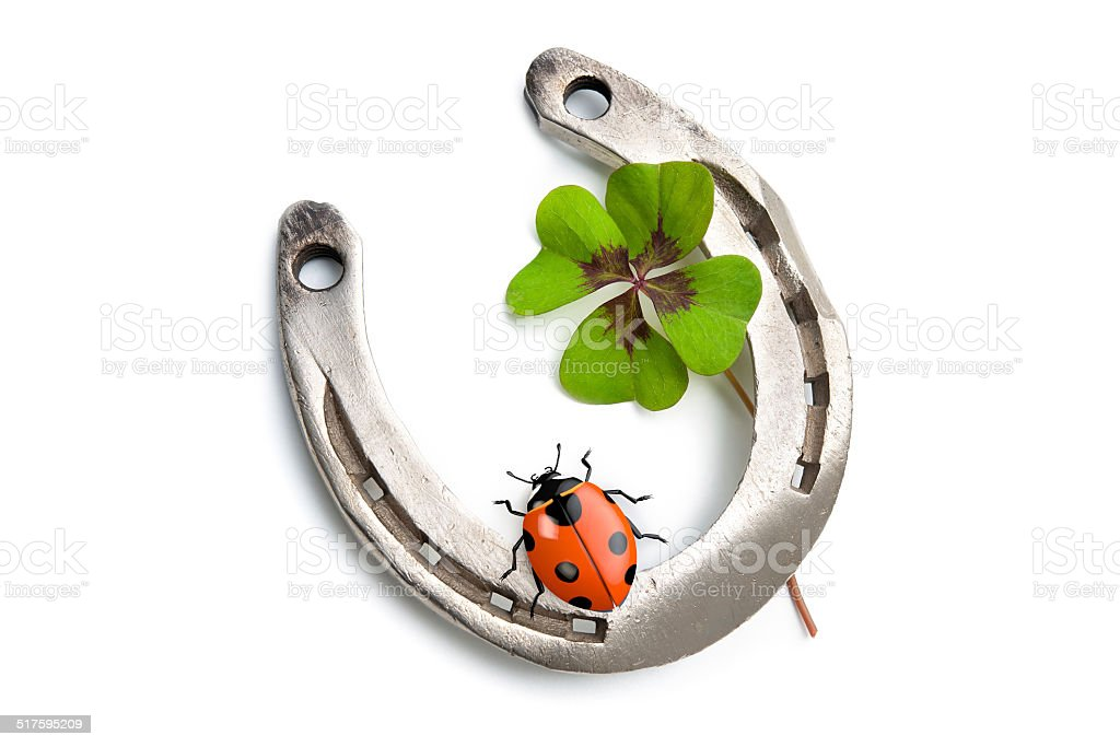 Horseshoes and four leaf clover stock photo