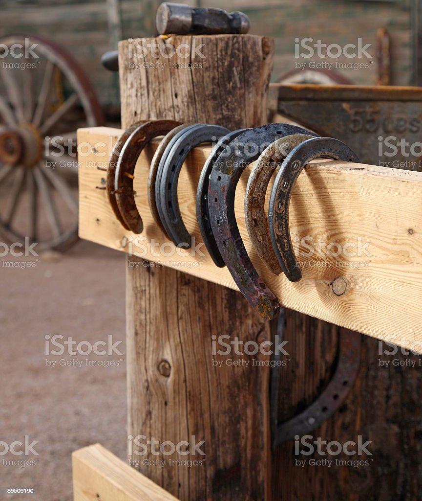 Horseshoes on the fence royalty-free stock photo