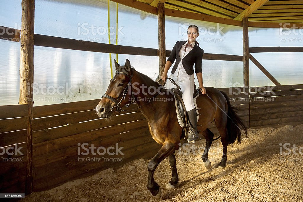 Horsewoman and horse training royalty-free stock photo