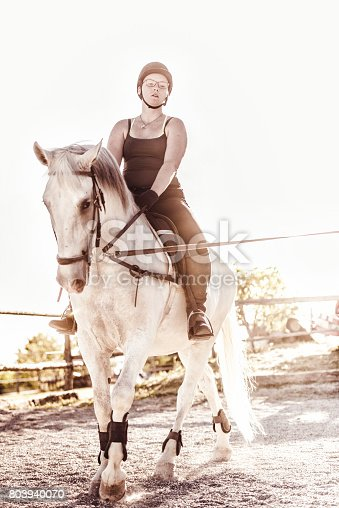 Horsewoman riding in a manege