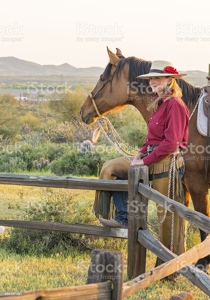 Horsewoman on split rail fence royalty-free stock photo