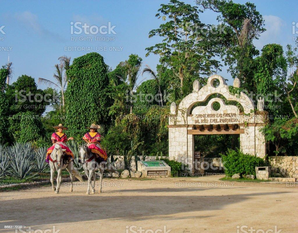 Horsewomen Riding Mexico stock photo