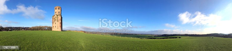 istock Horton folly tower and fields panorama, Horton, Dorset, England 1292738971