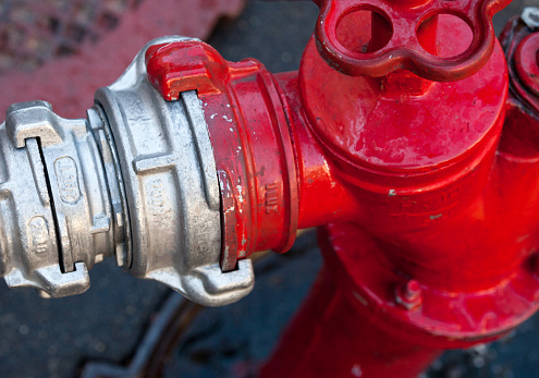 Hose coupling on the fire hydrant. Close-up.