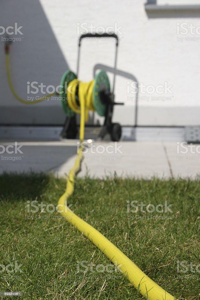 Hosepipe on a bobbin - Gartenschlauch auf Trommel stock photo