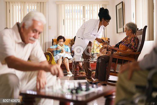 istock Hospice Doctor Measuring Blood Pressure To Senior Woman 520740570