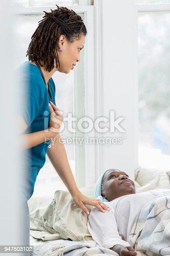 932074762istockphoto Hospice nurse checks patient's vital signs 947503102