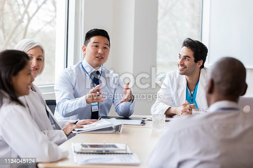 istock Hospital administrator conducts staff meeting 1134045124