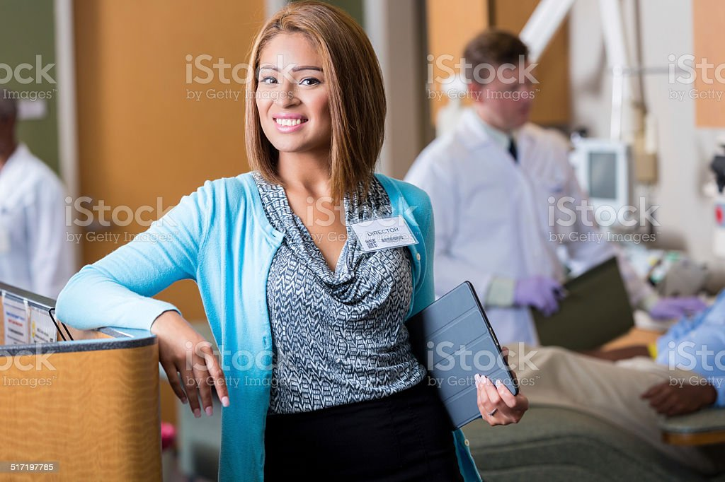 Hospital administrator in crowded blood bank donation center stock photo