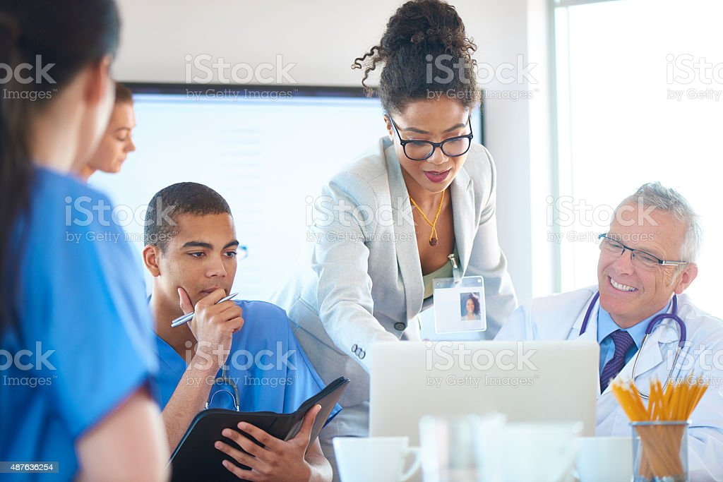 hospital administrator meeting with medical team stock photo
