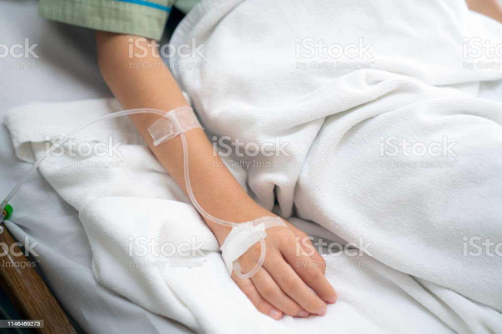 Hospital and patient concept, Asian patient woman sleep in bed with...