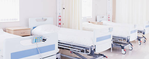 Hospital beds in empty room stock photo