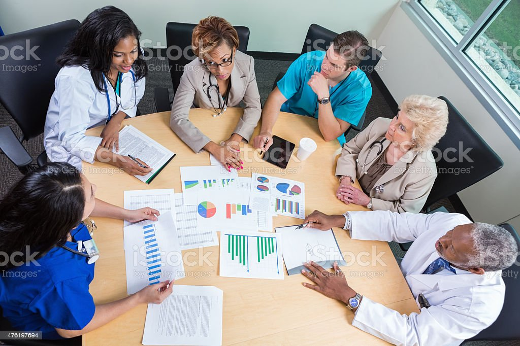 Hospital board meeting to discuss financial issues stock photo