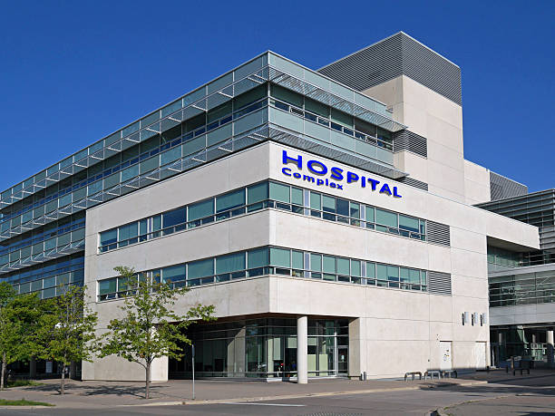 hospital building - hospital building stock photos and pictures