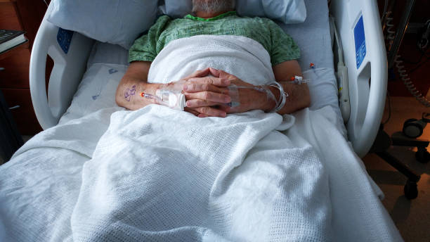 Hospital Cancer Surgery Patient Resting With Two IV Drips stock photo