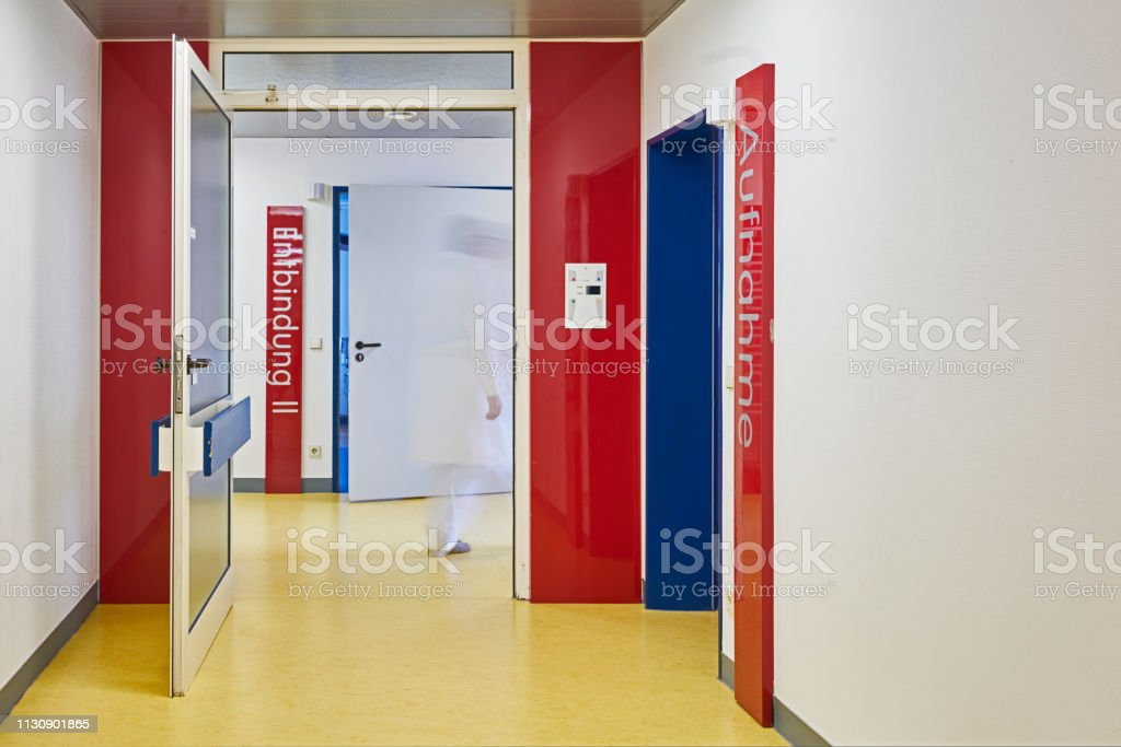 Hospital with corridor and sign Birth and admission of a ward with...