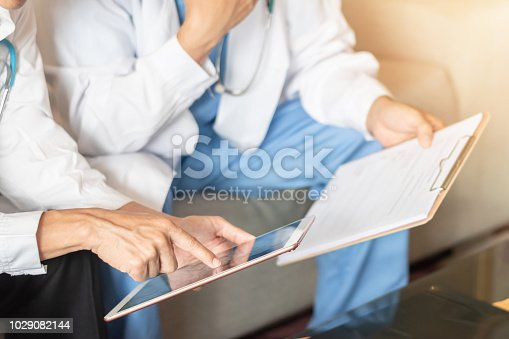 istock Hospital doctor teamwork, orthopedic surgeon, orthopedist, ER surgery team in medical clinic office meeting room discussing on diagnostic exam on patient care operation, professional service concept 1029082144