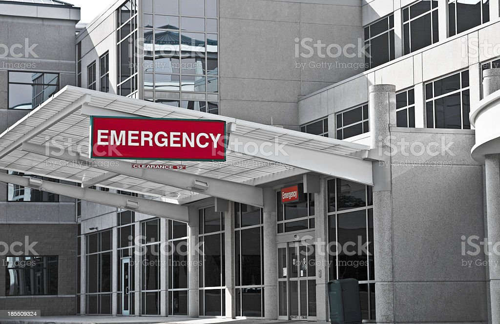 A hospital emergency bay area with a huge red signage stock photo