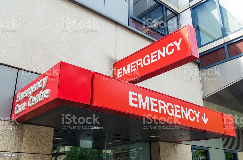 Hospital emergency department entrance Entrance to hospital emergency department at St Vincent's Hospital in Melbourne, Australia.  The sign is red with the word EMERGENCY prominently displayed. It can be used to illustrate various healthcare, medical and emergency concepts, from afflictions such as stroke or heart attack, diseases such as HIV or cancer, and accidents such as road trauma or sporting injury. Emergency Medicine Stock Photo