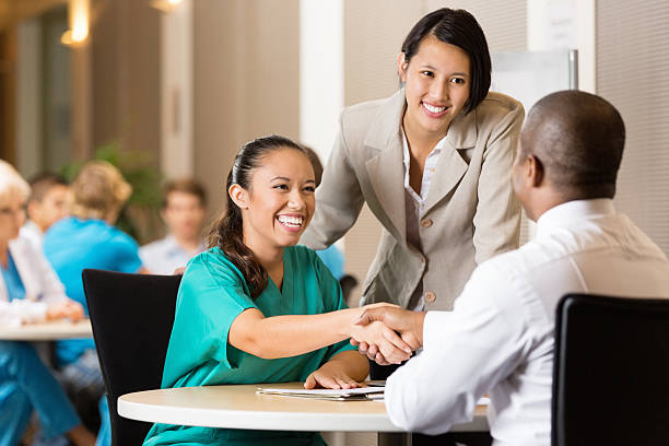 Hospital employee and nurse at job interview stock photo