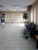 hospital hallway with a gurney, wheels and rails with a cool reflection in the floor