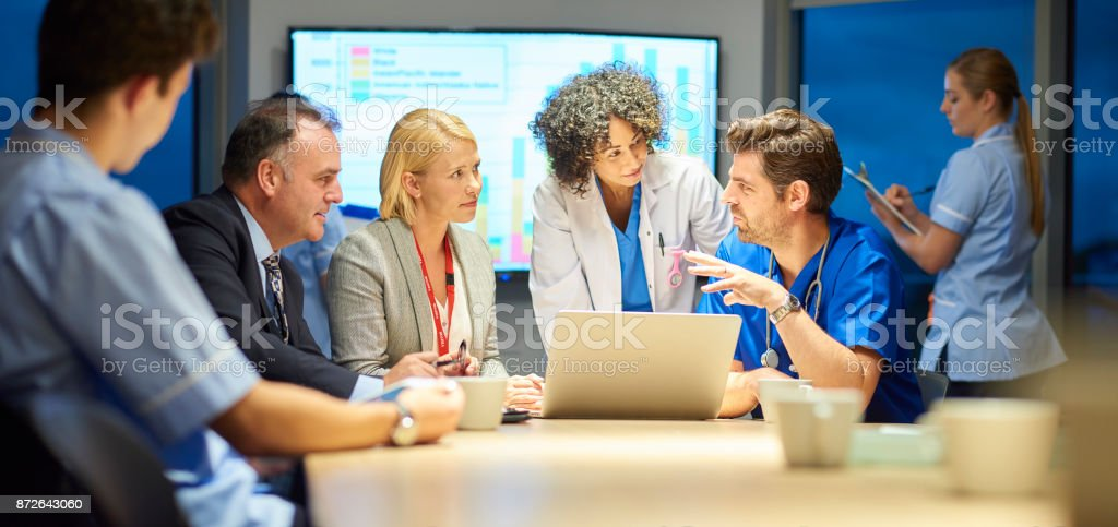 hospital management listening to doctor stock photo