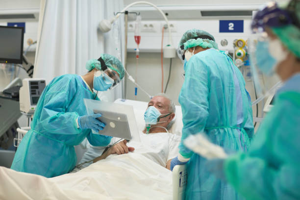 Hospital Nurse Holding Digital Tablet for Patient Video Call stock photo
