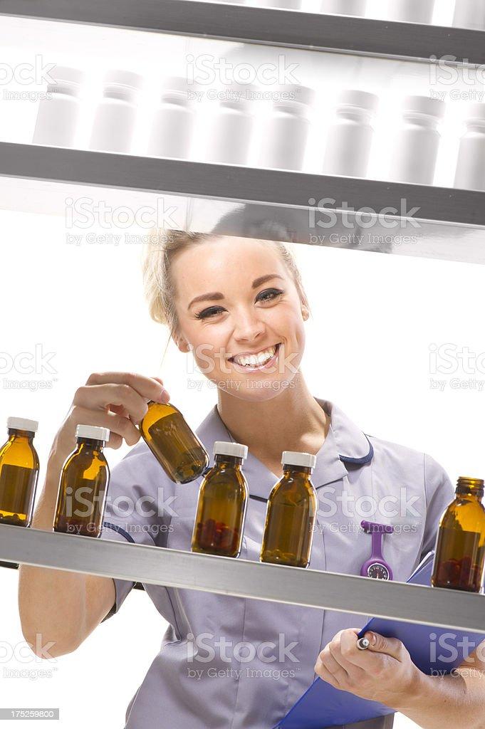 hospital nurse in pharmacy royalty-free stock photo