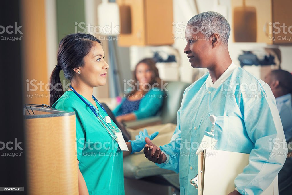 Hospital Nurses And Doctors Talking In Busy Emergency Room Royalty Free Stock Photo