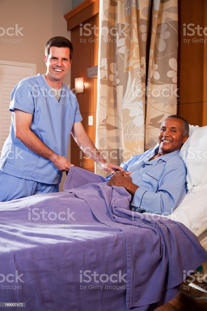 Hospital orderly assisting senior patient royalty-free stock photo