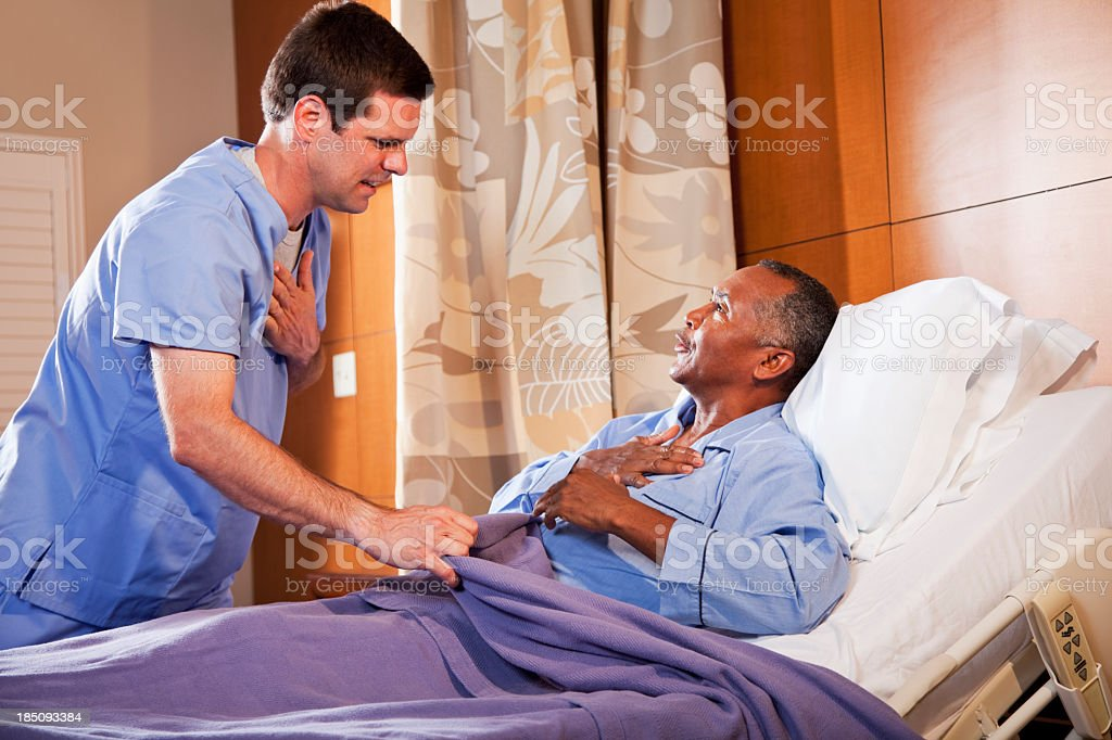 Hospital orderly talking with senior patient royalty-free stock photo