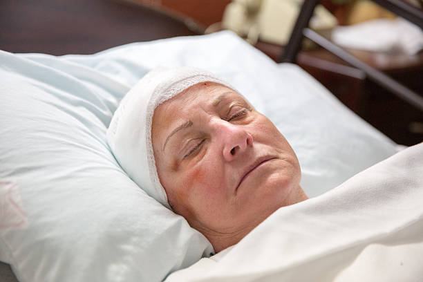 hospital patient sleeping - head injury stock photos and pictures
