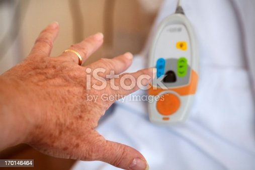 istock Hospital:  patient trying to reach call button 170146464