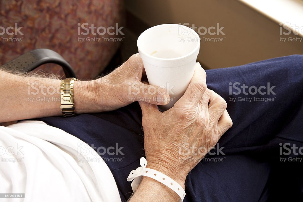 Hospital patient with coffee cup in his hands. royalty-free stock photo