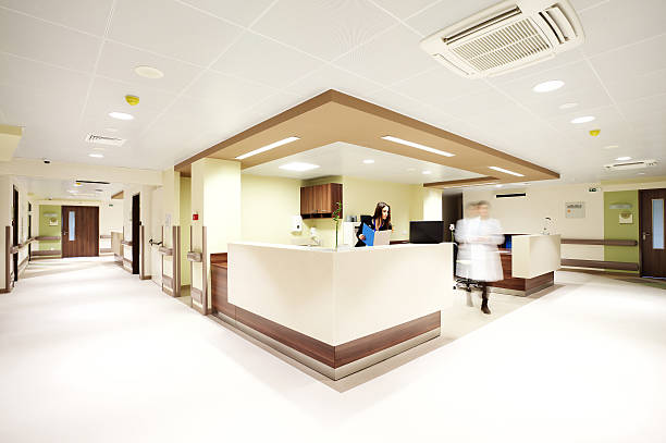 hospital reception corridor - receptionist stock photos and pictures