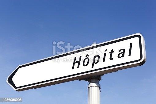istock Hospital road sign in France 1086096908