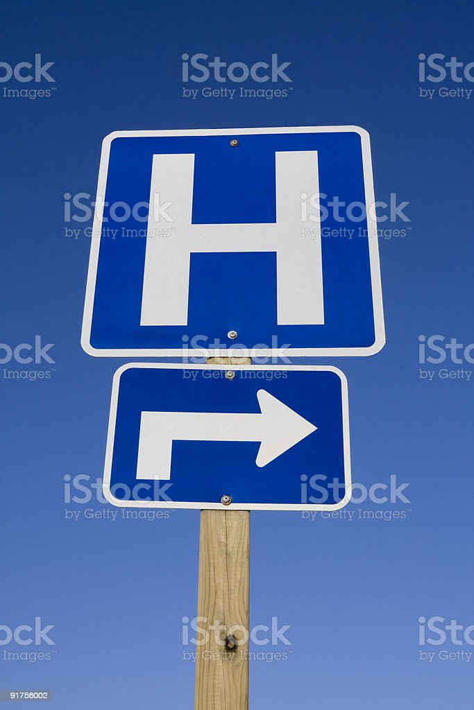 Hospital road sign with arrow stock photo