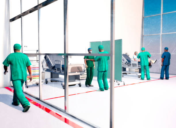 Hospital scene, hospitalization for emergency contagion risk. Coronavirus. Doctors in protective suits and masks to cover the face. Infectious epidemic risk stock photo