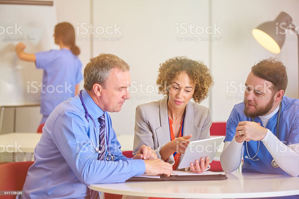 hospital senior staff meeting stock photo