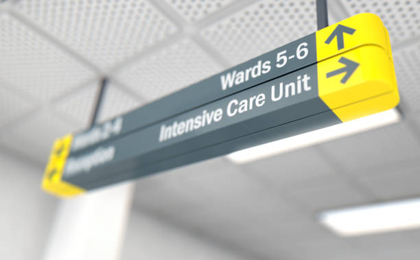 Hospital sign ICU A ceiling mounted hospital directional sign highlighting the way towards the intensive care unit - 3D render life support machine stock pictures, royalty-free photos & images