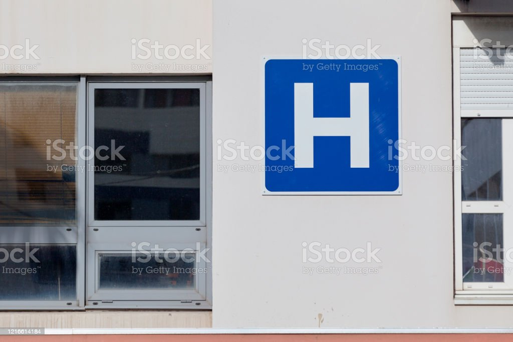 Hospital sign on the facade of an Hospital - Royalty-free Accidents and Disasters Stock Photo