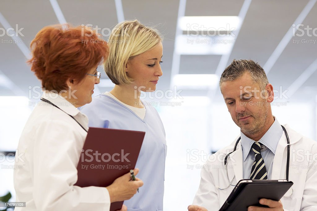 Hospital staff discissing stock photo