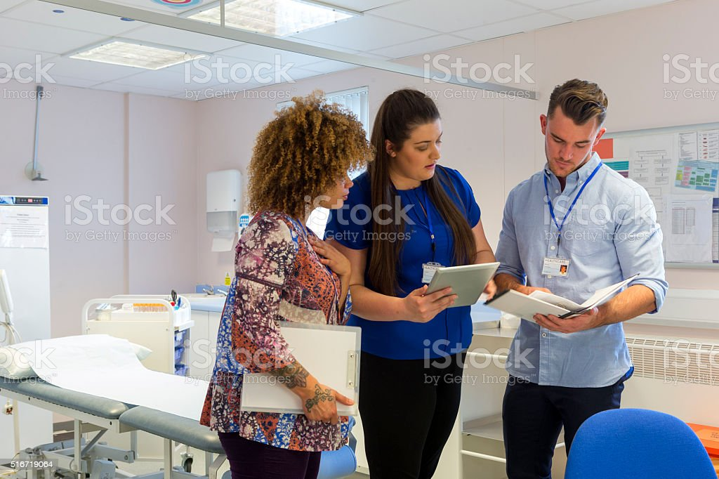 Hospital staff discussing patients medical results stock photo
