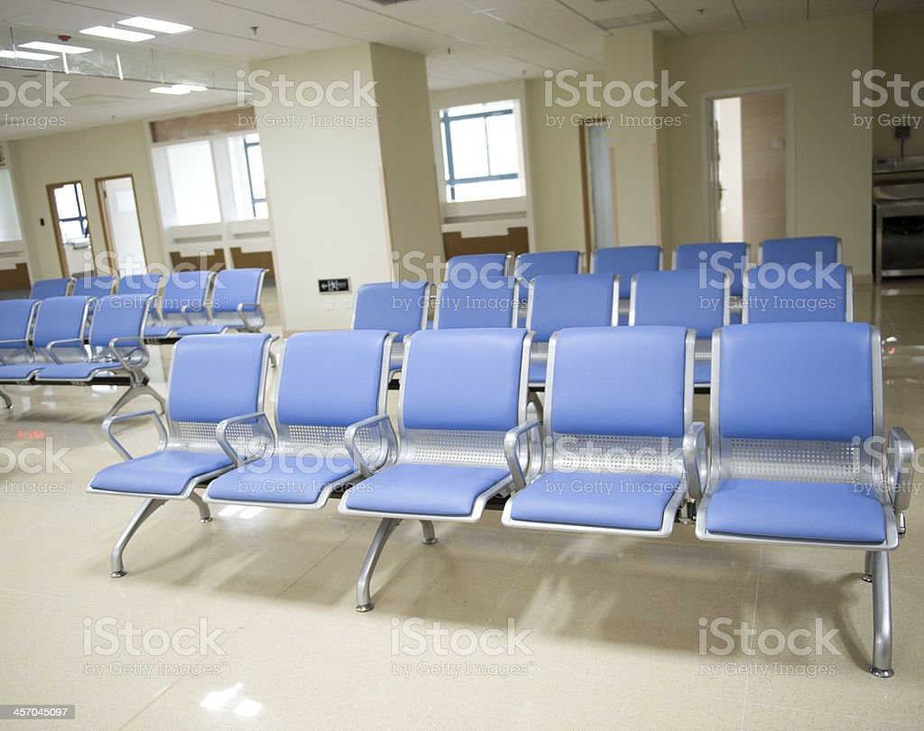 Hospital waiting room with empty chairs.