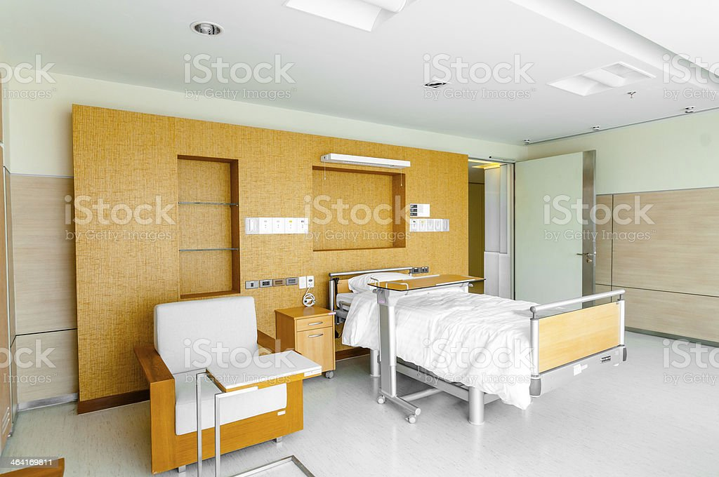 Hospital ward with bed and medical equipment stock photo